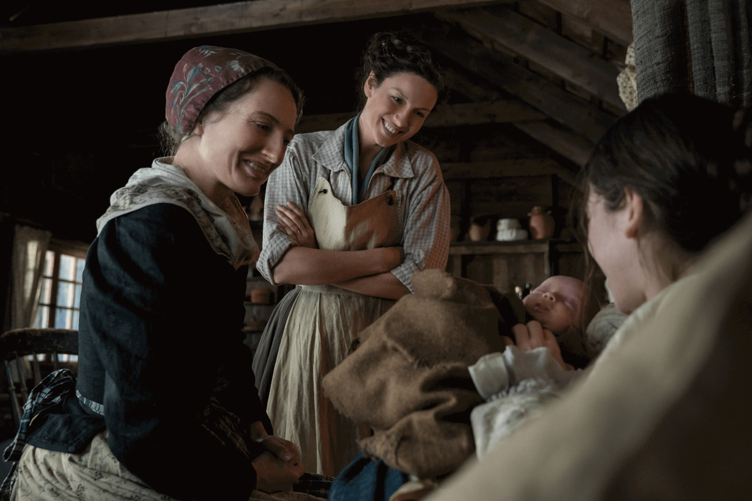 Outlander--Episode 5-Savages--Nicola Ransom (Rosewitha Mueller), Caitriona Balfe (Claire Randall Fraser), Marie Hacke (Petronelle Mueller)
